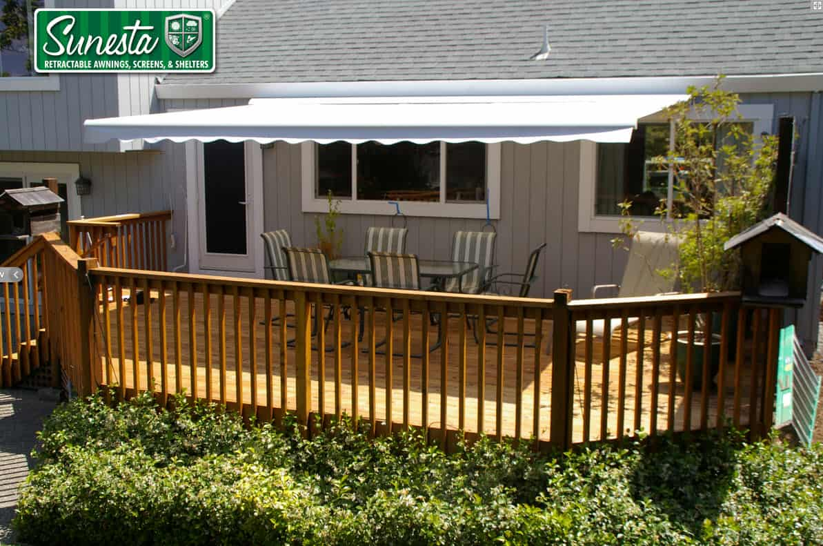 How do Retractable Awnings Handle Rain, Snow and Storms?